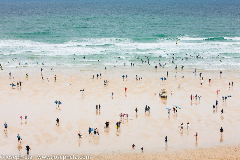 Wall art photo of surfers at Watergate Bay in Newquay, Cornwall