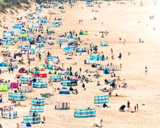 Wall art photo of people sun bathing at Fristal beach in Newquay