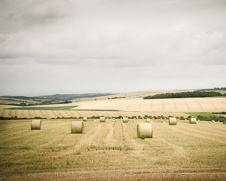 Wall art photo of hay bales on a farm in the summer