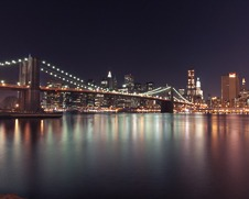 A photo of the Brooklyn Bridge with the manhattan skyline in the back