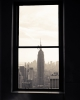 Wall art photo of the empire state building through a window