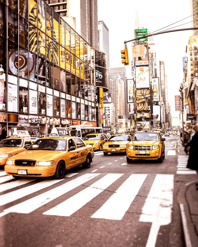 A wall art photo of yellow cabs on Time Square, New York City