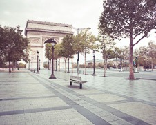 A wall art photo of a side walk on the Champs Elysee in Paris