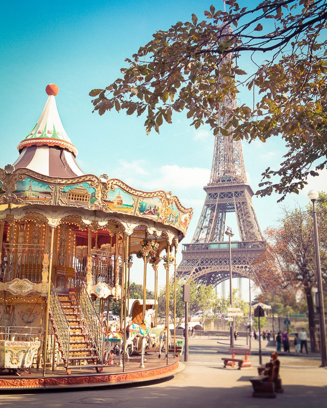 A dreamy wall art photo of a carousel and the Eiffel Tower in Paris