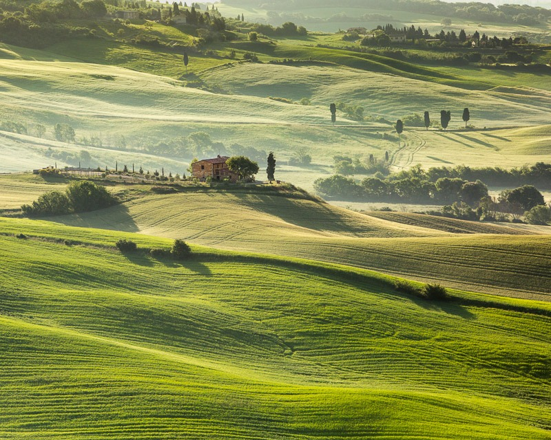 a fine art print of a farm house in a Tuscan valley