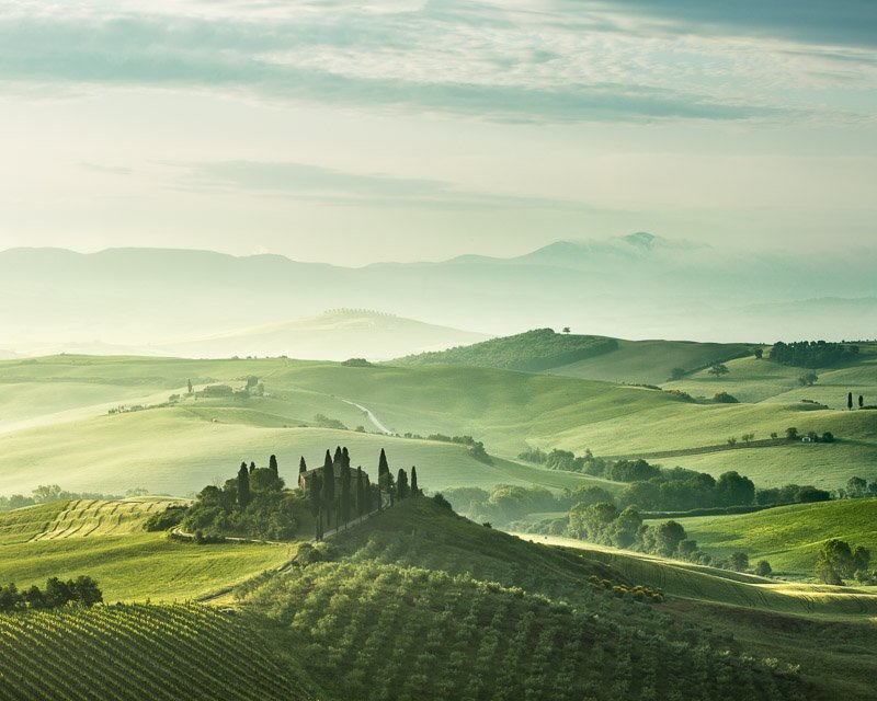 a fine art print of a villa in a valley in Tuscany